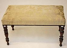 A RECTANGULAR WINDOW OR DRESSING STOOL,  covered in attractive beige fa