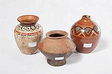 A VERY EARLY SOUTH AMERICAN TRIBAL POTTERY JAR,  of baluster form, 4in