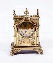 AN ATTRACTIVE GOTHIC STYLE BRASS MANTEL CLOCK, of architectural design, the