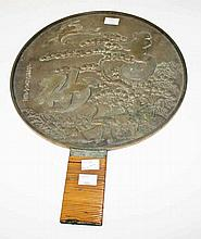 A JAPANESE CIRCULAR BRASS MIRROR,  decorated chased with cranes and fol