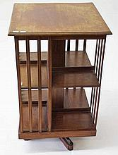 A MAHOGANY REVOLVING BOOKCASE,  with square moulded top and slatted sid