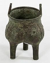 AN EARLY CHINESE BRONZE TRI-POD CENSER,  with relief moulded tri-form b