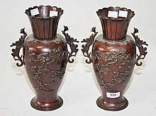 A PAIR OF JAPANESE BRONZE VASES,  each of baluster form, with birds and
