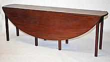 AN IRISH MAHOGANY HUNT OR WAKE TABLE,  in the Georgian style, with two