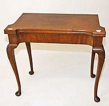 A MAHOGANY CARD TABLE,  In the George II style, probably by James Hicks