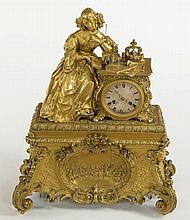 A 19TH CENTURY FRENCH GILT MANTLE CLOCK,  with silk suspension movement