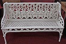 A PAIR OF HEAVY CAST IRON GARDEN BENCHES,  each back pierced with typic