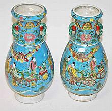 A PAIR OF CHINESE PORCELAIN VASES,  O.R.M decorated with figures and de