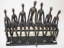 A BRONZED RESIN GROUP,  in the style of Edward Delaney, modelled with s