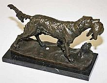 A BRONZE GROUP AFTER J. MUIGNIEZ,  modelled as a gun dog with bird in m