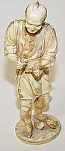 A JAPANESE IVORY OKIMONO,  modelled as a man with implement in his hand