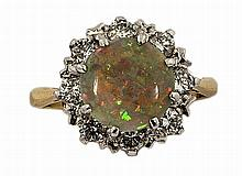 A FINE OPAL AND DIAMOND CLUSTER RING,  on 18ct yellow gold band. (1)