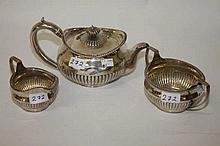 A THREE-PIECE SILVER TEA SERVICE,  George III, by R & S Hennell, London