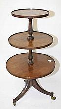 A GEORGE III STYLE THREE TIER DUMBWAITER,  with circular graduating she