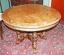 A CIRCULAR CONTINENTAL WALNUT AND BURR MAPLE CENTRE TABLE, 19th century, th