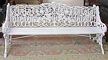 A PAIR OF ATTRACTIVE HEAVY CAST IRON GARDEN BENCHES,  each pierced and