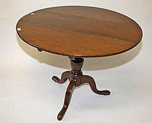AN OAK AND ELM PROVINCIAL CENTRE TABLE,  early 19th century, the circul