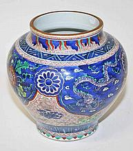 A HEAVY CHINESE PORCELAIN VASE,  of bulbous form, decorated with dragon