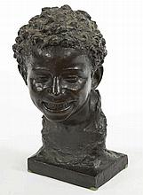 AN ITALIAN BRONZE BUST  modelled as a young boy with curly hair, on rec