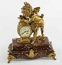 AN ATTRACTIVE HEAVY FRENCH GILT METAL MANTEL CLOCK,  c. 1900, with larg