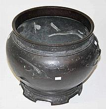 A LARGE JAPANESE BRONZE JARDINIERE,  with birds and foliage in relief a