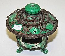 A CHINESE GREEN GLAZE AND PIERCED CERAMIC LANTERN CENSOR,  basket bound