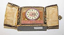 A SMALL MARBLE GILT MANTEL AND ENAMEL TRAVELLING TIME PIECE,  the circu