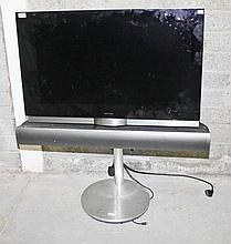 A BANG & OLUFSEN 33IN TELEVISION,  With fixed sound board. (1) as is.