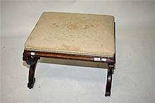 A VICTORIAN WALNUT FOOTSTOOL,  with padded feet on X-framed supports on