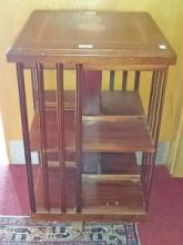 A MODERN MAHOGANY INLAID AND CROSS BANDED REVOLVING BOOKCASE, with slatted