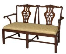 A GEORGE III PERIOD MAHOGANY DOUBLE CHAIR BACK SETTEE, the shaped and leaf