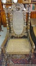 A PAIR OF CARVED OAK ARMCHAIRS OR THRONE CHAIRS, late 19th century in the 1