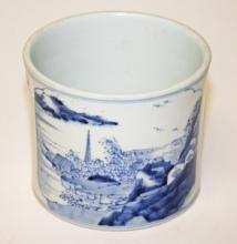 A LARGE CHINESE BLUE AND WHITE PORCELAIN BRUSH POT,  decorated with figures