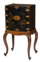 A 19TH CENTURY JAPANESE LACQUERED AND GILT METAL MOUNTED CABINET,  with two