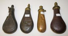 FOUR 19TH CENTURY POWDER FLASKS,  one leather bound Dixon & Sons patent, 8.