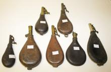 SEVEN ASSORTED PLAIN STICHED LEATHER SHOT FLASKS,  one Battie patent and on