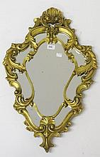 A CARTOUCHE SHAPED GILT WALL MIRROR, with shell