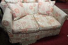 A PAIR OF MODERN TWO SEATER SETTEES, each covered