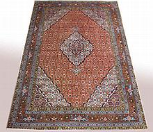 AN ATTRACTIVE TABRIZ CARPET, with centre turquoise
