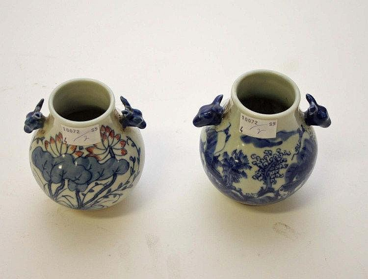 TWO SIMILAR CHINESE BLUE AND WHITE VASES, one