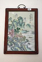 A CHINESE FAMILLE VERTE PORCELAIN PANEL,  depicting a mountainous river lan
