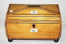 AN UNUSUAL EBONY STRUNG SATINWOOD TEA CADDY,  William IV period of casket f