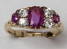 A RUBY AND DIAMOND RING, set with three ruby's and four diamonds, 18K yello