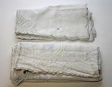 A LARGE CUT WORK AND EMBROIDERED TABLE CLOTH,  with nine matching napkins,