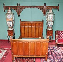 AN UNUSUAL GOTHIC STYLE OAK HALF TESTER BED,  the canopy with fold out side