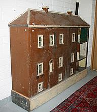A LARGE SIX BAY PAINTED WOODEN DOLL'S HOUSE,  probably c. 1900, with three