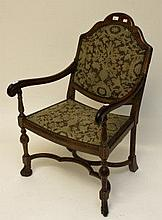A WILLIAM AND MARY STYLE WALNUT ARMCHAIR,  with padded back and seat, raise