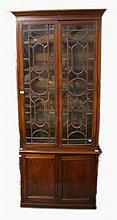 A 19TH CENTURY MAHOGANY BOOKCASE SECTION,  with moulded cornice, above two