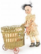 Bisque Doll Pushing Cart