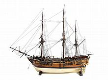 A MODEL OF HMS BOUNTY, EARLY-MID 20TH C of varnished wood, painted cre